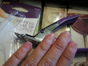 I bought this Artificial Nail Tip Clipper at Walmart for about $4. I then cut my nails down to the skin.